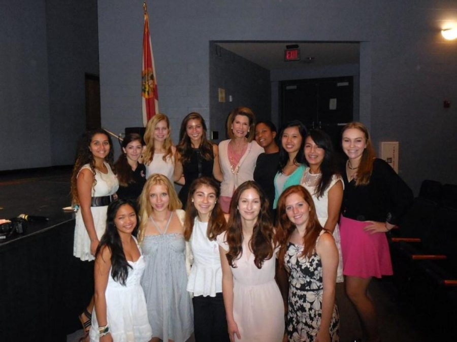 The board members for the ThinkPinkKids Club and the Women's Empowerment Club with Ambassador Nancy Brinker after her key note speech.  (From left, back row) Strings junior Fabiola Plaza, communications sophomore Taylor Rich, strings senior Rachel Randolph, communications senior Sydney McAuliffe, strings senior Giselle Graham, keyboard sophomore Catherine Zeng, communications junior Maria Grosso, and visual arts junior Emily Gerstein. (From left, front row) Strings senior Kaye Guardiario, digital media sophomore Beatrice hood, strings sophomore Juliet Schriber, theatre senior Katherine Schauer, and theatre junior Katelyn Megan Walsch.