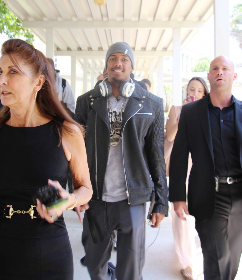 """Nick Cannon (middle) walks to the cafeteria to DJ during lunch and debut the songs from his new album, """"White People Party Music."""""""