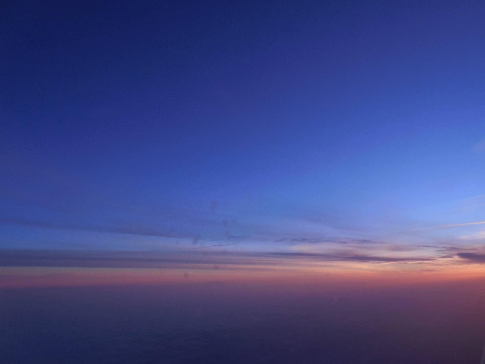 Sun rise over Germany on a plane.
