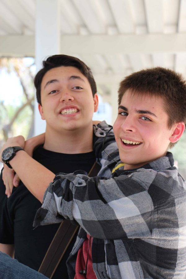 """(L-R) Parker Wall and Paul Pain enjoy a comfortable embrace for the camera. """"I do think the media is censored. It is a lot better in the United States than in other countries, but there is a lot of work to be done for ultimate freedom of speech,"""" Wall said."""