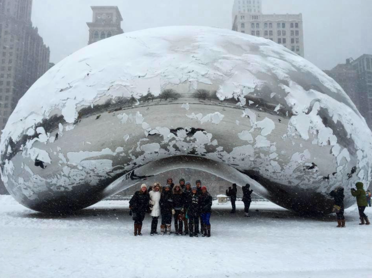 Theatre seniors stand in front of The Bean in Chicago.