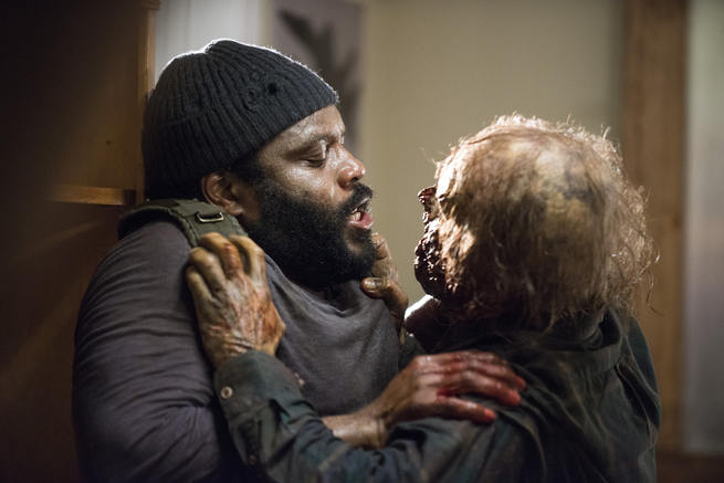 Tyreese+fends+off+walker.%0APhoto+by+AMC