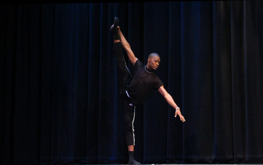 Dance sophomore Darius Hickman, winner of the Mr.Dreyfoos pageant hosted by A Prom to Remember: Operation Dreyfoos, performs his  dance routine for the talent portion of the contest.