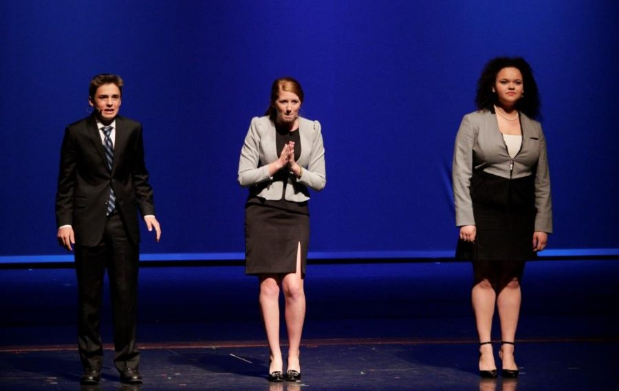 Debate team members  (L-R) communications freshman Garret O'Donnell,  communications senior Morgaan Jessell and communications junior Bethany Ebanks act out their skit in the showcase.