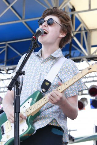 Theatre sophomore Ben Rothschild sings during Jumbo Shrimp's performance at SunFest on Sat. May 2.