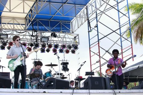 (L-R) Lead singer theatre sophomore Ben Rothschild, drummer Palm Beach Gardens High School junior John Cardillo III and theatre major and bass player Angel Leiser play at SunFest with their band, Jumbo Shrimp.
