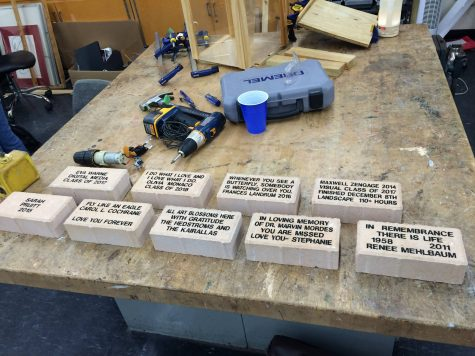 Some of the engraved bricks ready to be placed in the garden.