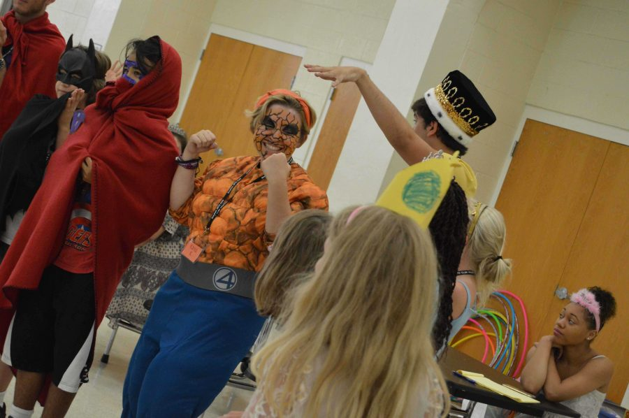 Communications junior Kayla Kirschenbaum has fun with campers as she dresses as the hero Thing from