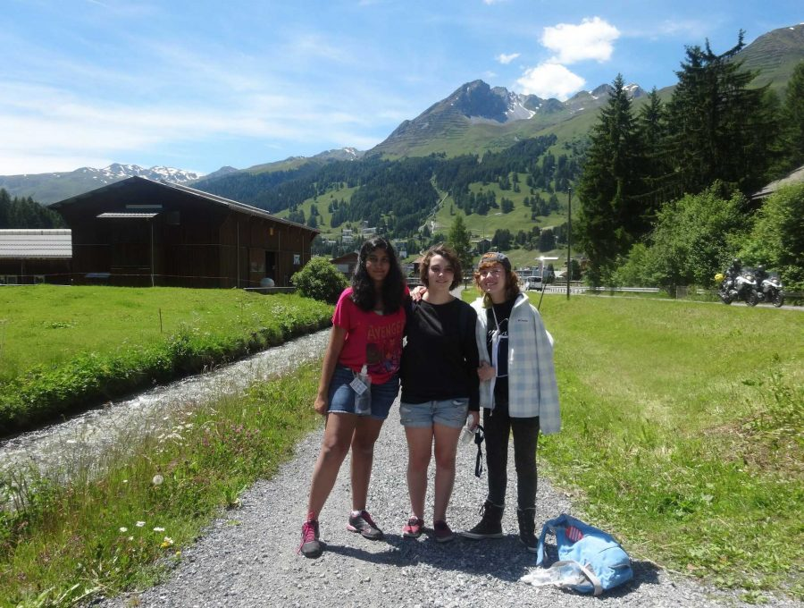 (L-R) Communications juniors Uma Raja, Samantha Marshall and Brianna Steidle take a picture in front of the Swiss Alps in Davos.