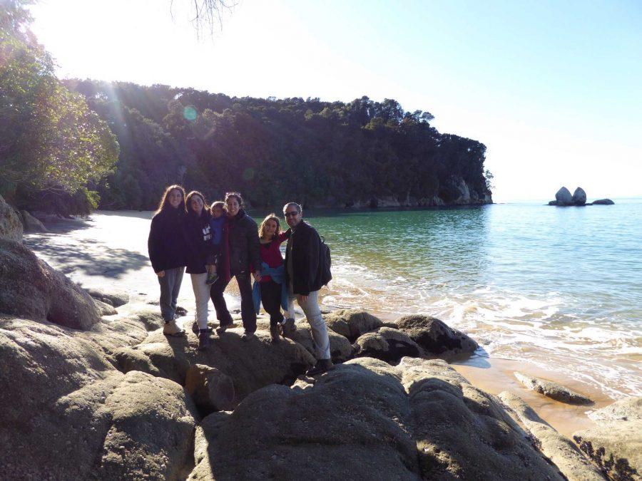 Communications junior Tom Kapitulnik  with her family at the Split Apple Rock beach.