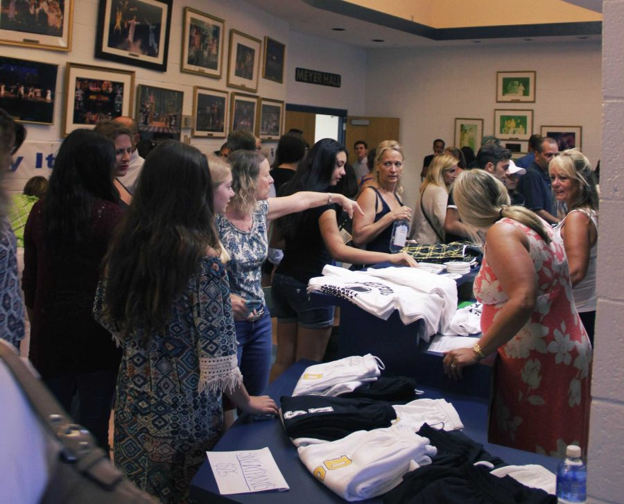 The PTA and Dreyfoos organizations sold merchandise for new students.