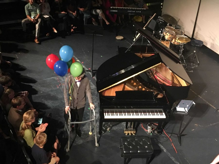 Piano junior Stefan Wan dresses as Carl Fredricksen while playing the main theme from Up during the Oct. 9 performance of Impromptu.