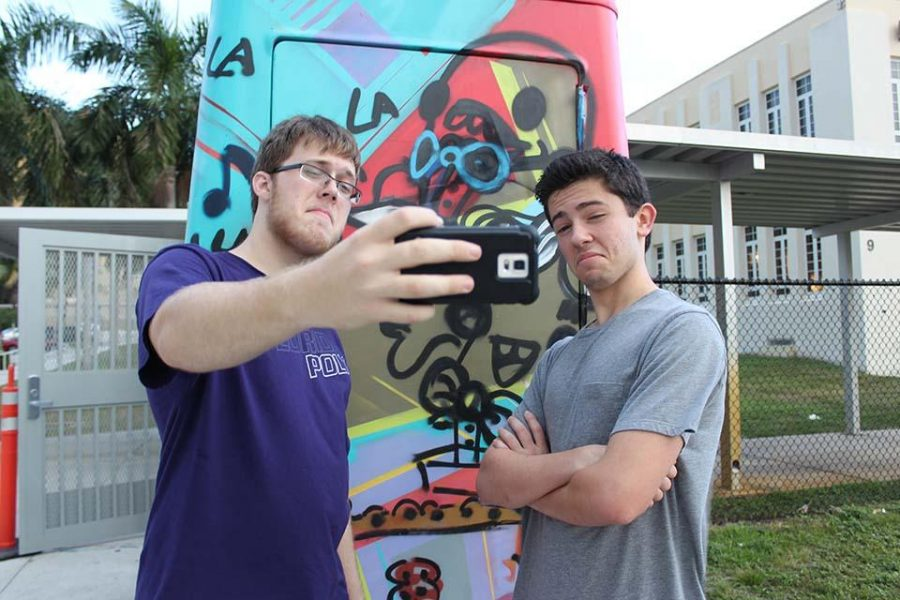 Taking a selfie with the coke cart, theatre senior Marshall Tobias (L-R) and band senior Daniel Stern compete in the National Honor Society's (NHS) first social event. The event featured a scavenger hunt requiring participants to solve clues that led them to a specific location where they took a selfie.
