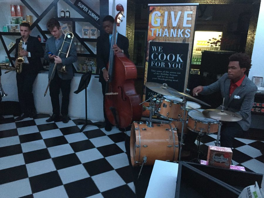 Near the main entrance of the EmKo Restaurant and Art Gallery, band juniors Tommy Gallagher (L-R), Nick Forte, Mark Ligonde, and Ahmad Johnson perform their Jazz Combos.