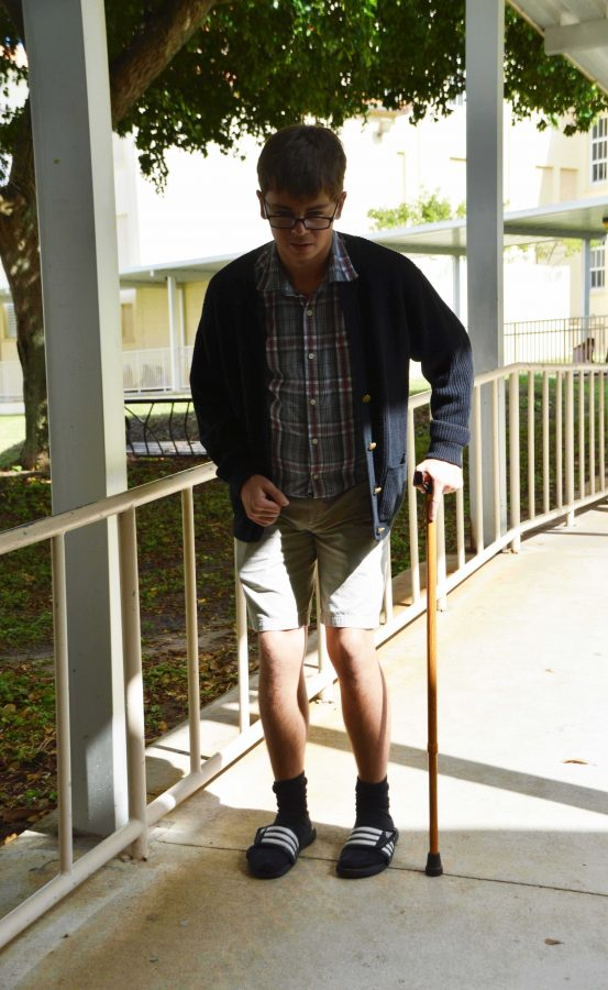 Band senior Ryan Hall makes his way to lunch dressed as an old man while participating in