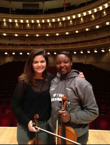 Strings senior Kevonna Shuford stands with her friend Allie Switala in Carnegie Hall. Both of them are alumni of the Sphinx Competition, and were Sphinx Representatives at the seminar.