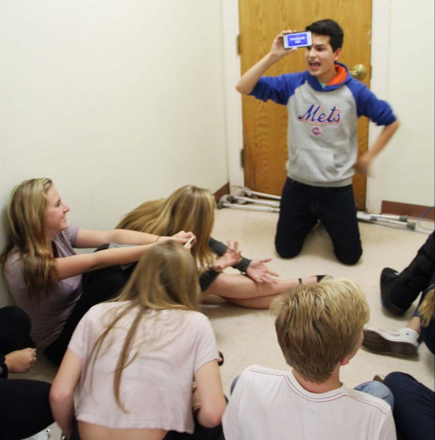 Communications freshman Michael Bole plays games with friends as they wait for the end of a tornado warning on Jan. 15.