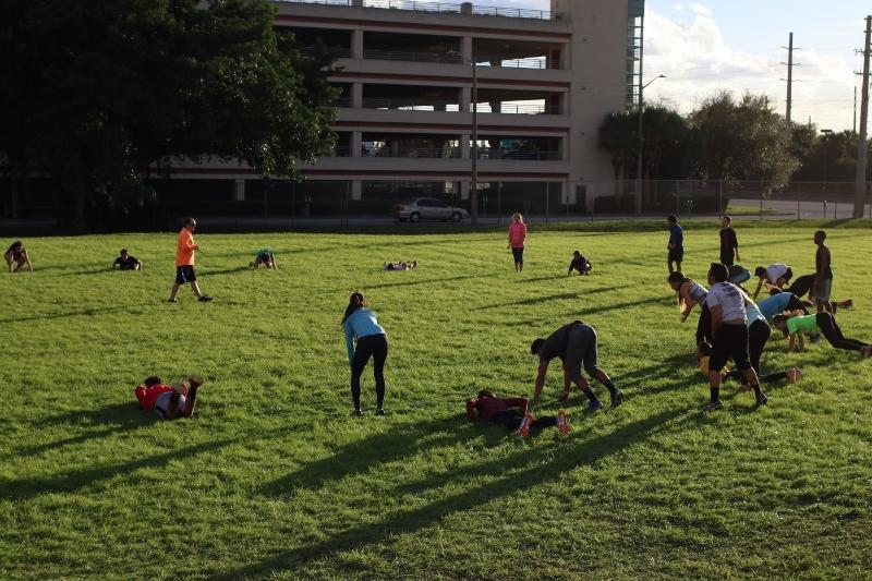 The+Dreyfoos+track+and+field+team+warms+up+with+an+exercise+called+burpees.+The+team+has+been+conditioning+since+Jan.+12.+%22It%27s+a+lot+more+intense+than+last+year%2C%22+vocal+senior+Jacob+Crossey+said.+%22We+do+a+lot+of+strength+exercises+more+than+running+in+practice.%22