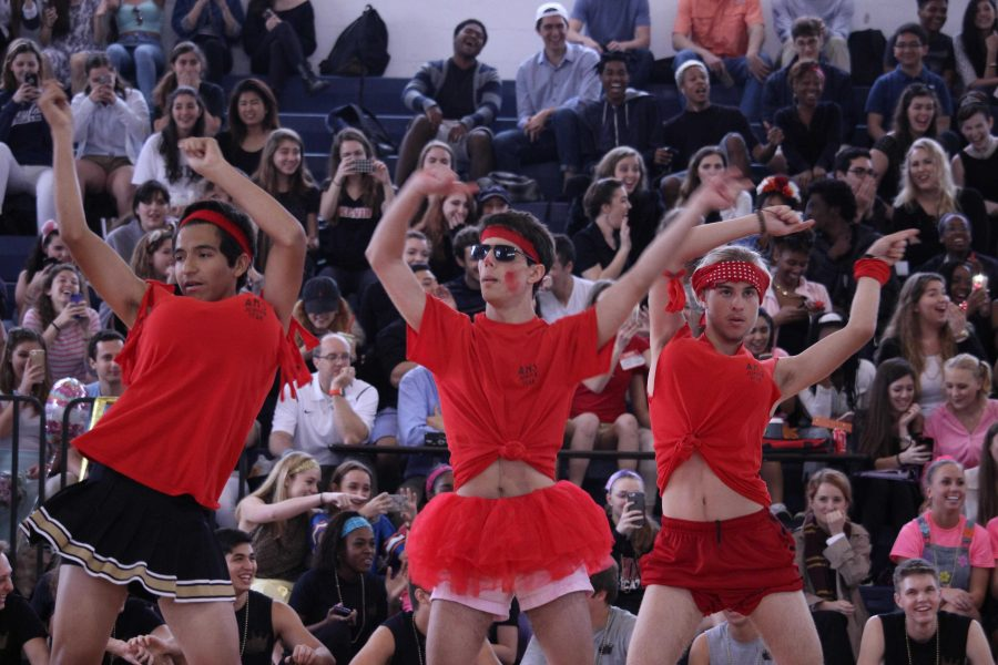 Communications junior Daniel Montoya (L-R), communications junior Daniel Kaufman, and visual junior Bjorn Corning perform in the junior Powderpuff cheer routine.