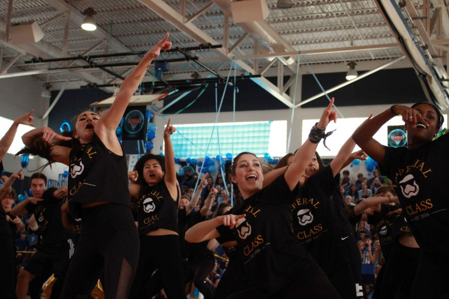 Dance senior Melanie Breaux (L-R), band senior Amber Chu, and dance seniors Francesca Horvath and Sierra Cooper dance in the seniors' final Pep Rally Dance. Seniors won first place.