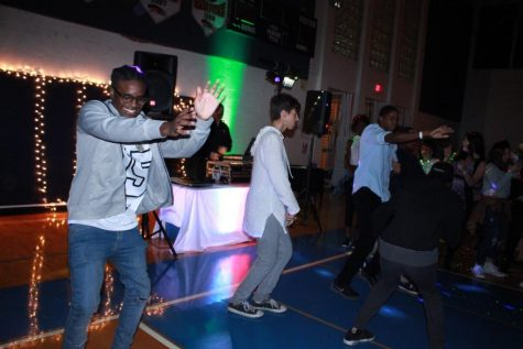 "Vocal senior Josh Johnson (left) dances at Homecoming on Jan. 29. It was untraditional this year, with a ""House Party"" theme that allowed more casual attire and offered many games for students to play and win prizes."