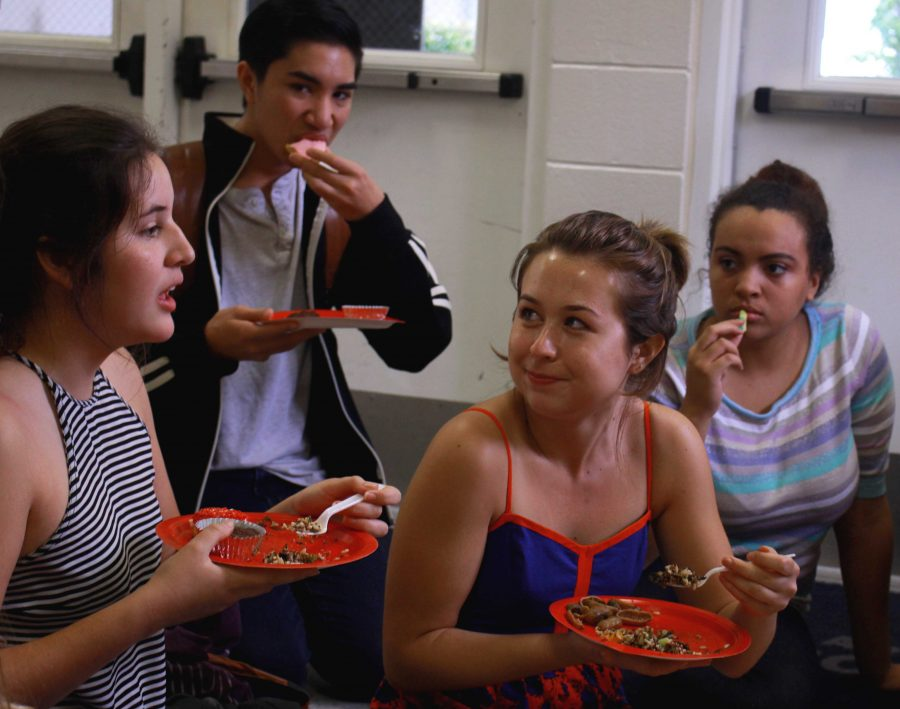 Digital senior Valentina Suarez (L-R), theatre sophomore Kai Horvit, visual senior Jessica Kian and theatre sophomore  Azure Kordick partake in an all vegan potluck lunch that was hosted in the gym on Feb. 16. Over 10 students brought vegan lunch and desserts, including quinoa and ice cream to share.