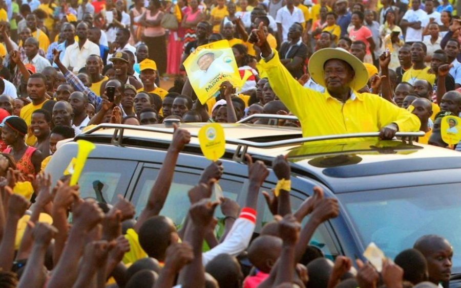 Ugandan president Yoweri Museveni waves to supporters as he arrives at a campaign rally in Entebbe ahead of the presidential elections this week.