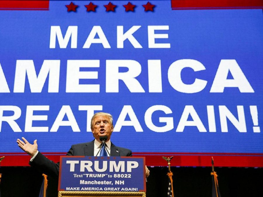 Real-estate tycoon and Republican presidential candidate Donald Trump delivers a speech in Manchester, New Hampshire, on the eve of the state's influential Republican presidential primary.