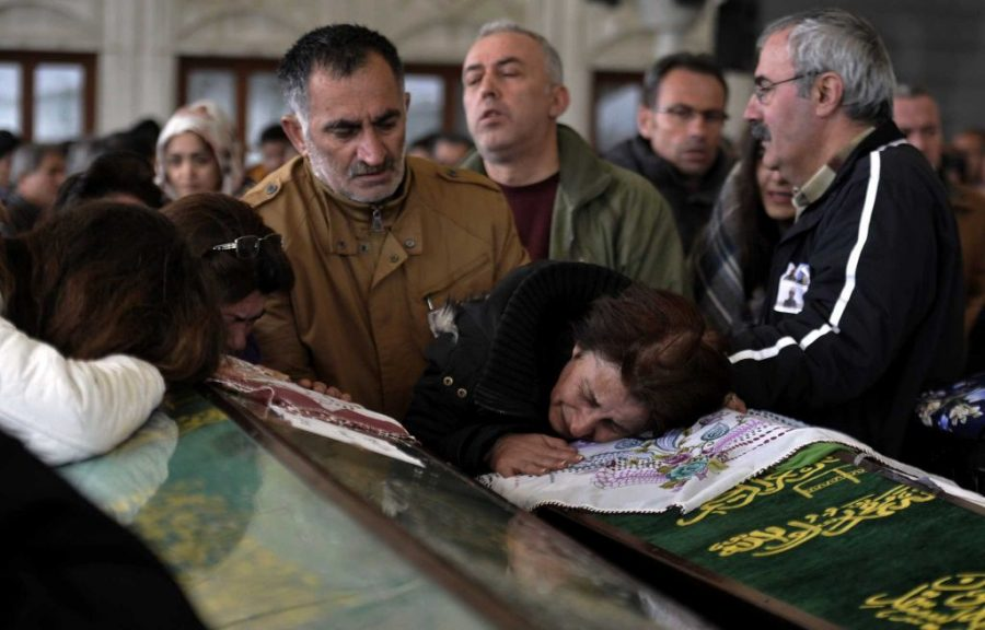 Members of the Cermik family attend a funeral procession for three members of their family killed in Sunday's bombing in Ankara, Turkey on Monday, March 14, 2016.