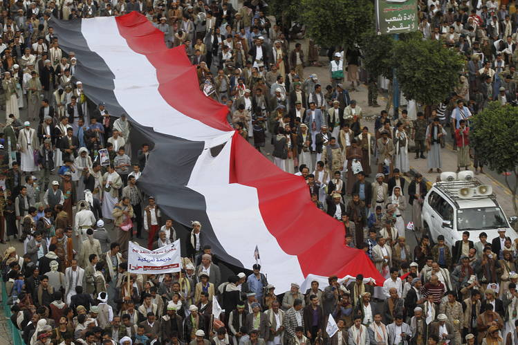 Followers of the Houthi movement hold a giant Yemeni flag during a rally against U.S. support for Saudi-led air strikes in Yemen's capital San'a earlier this month.