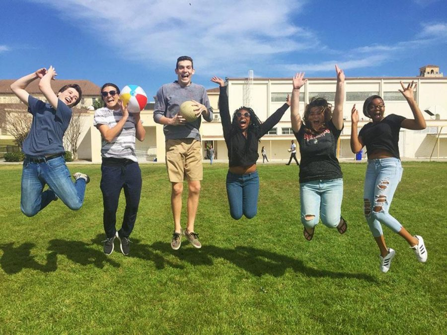 Communication juniors Jake Perl (L-R),  Nick Oregero, and Oscar Hamilton, communications senior Karai McLean, and communications sophomores Dylan Pollock and Alexa Pope jump in excitement as they count down the days until Spring Break.