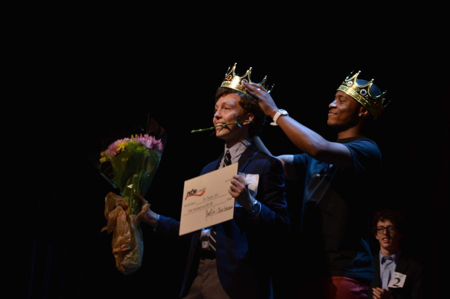 Dance junior and 2015 Mr. Dreyfoos Darius Hickman crowns the 2016 winner, theatre senior Matthew Paszkiet, at the second annual Mr. Dreyfoos Pageant hosted by A Prom To Remember on April 14 in Meyer Hall.