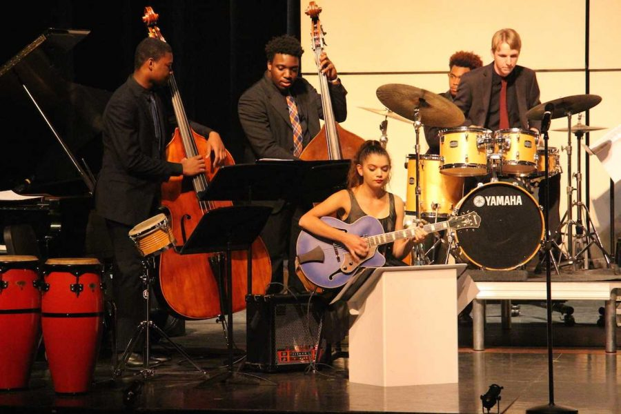 """(L-R) Band seniors Ahmad Johnson,  Joshua Ewers, Garrett Anderson, and band sophomore Nikki Lickstein perform during a rendition of """"Rotten Kid"""" """"I dedicate this song to all the kids on stage because they stink,"""" Hernandez said. """"But in all seriousness, when we performed this at the Central Jazz Competition, we were greeted with massive applause and asked to perform an encore."""""""