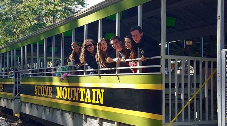 Vocal juniors Isabella Guerrero (L-R), Makayla Forgione, Michael Martin, Judianna Meyers-Sinett, and Jared Freedland ride the train at Stone Mountain Park the afternoon before the competition.