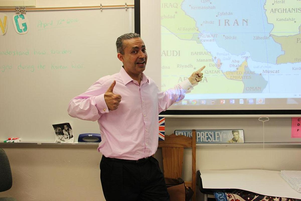 Social studies teacher Dr. Gary Bicker points to his soon-to-be home, Bahrain, on a map (the red country). Over the summer, he is moving to Bahrain, where he was offered a position to teach eighth grade social studies at an international school.