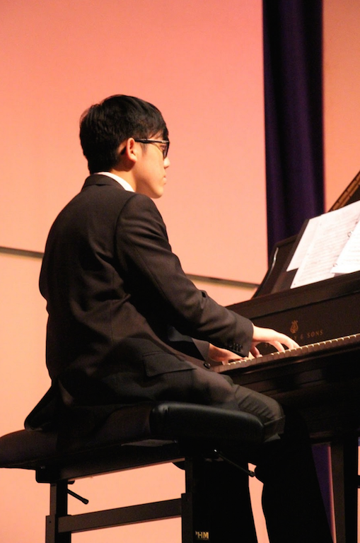 Piano junior Stefan Wan plays a solo piece in the