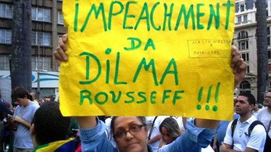 A protester holds a sign calling for the impeachment of Brazilian prime minister Dilma Rousseff.