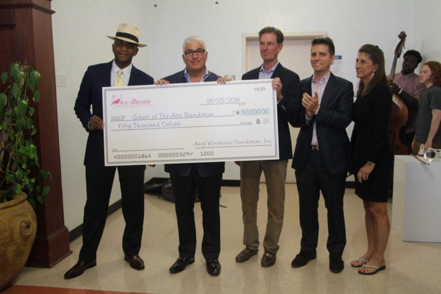 Board of Directors of Dreyfoos member Patrick Cousins (L-R), Mitch Winehouse, Board of Directors of Dreyfoos member Bill Fritz, Board of Directors of Dreyfoos member and Dreyfoos alumnus Brandon Levine, and Principal Dr. Susan Atherley present the $50,000 check from the Winehouse Foundation.