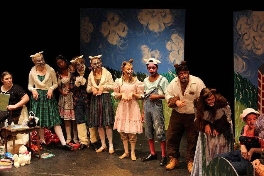 Theater sophomores Maddy Stillman (L-R), Lexi McCain, junior Nia Bourne, sophomore Chase Rook and Madison Burmeister, freshman Olivia Troast, juniors Michael Joseph and Jay Jennings, senior Grace Wess, and freshman Danielle Goldfine stand on the stage in a declaration of friendship and unity. After being displaced from their respective stories, the characters come together in the end and plan their futures together.