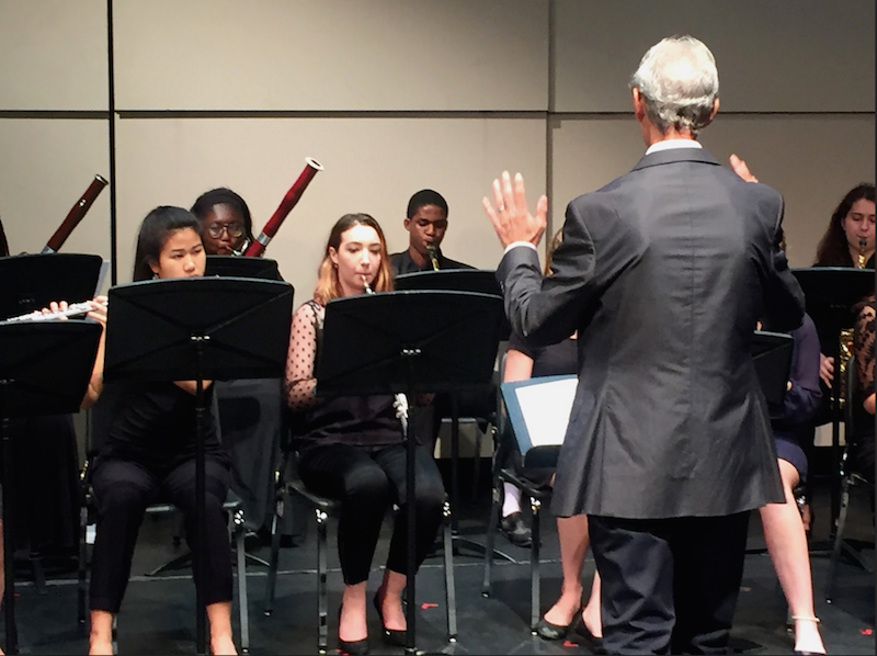 """Artist in residence Michael Porte directs the Woodwind Choir during the ensemble """"Adagio et Allegretto"""" by Charles Gounod. The group had to adapt the notes of the song to fit their particular set of instruments."""