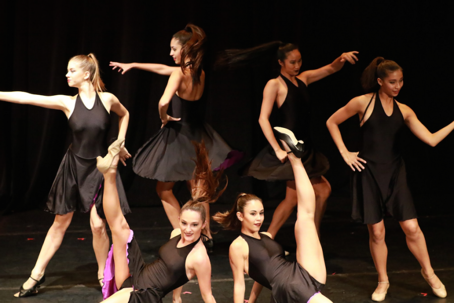 """Dance sophomores and juniors perform """"Love is a Tender Trap."""" The routine was choreographed by dance junior Nicole Carroll."""