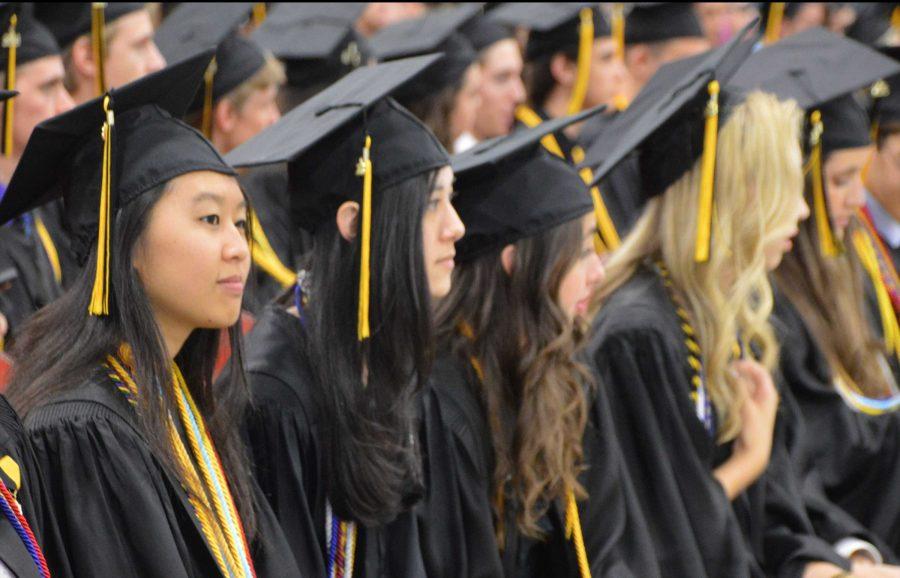 Piano senior Tiffany Chen (L-R), digital media senior Nina Marchell, piano senior Alexandra O'Brien, dance senior Morgan Aumick, and digital media senior Valentina Suarez wait to receive their high school diplomas.