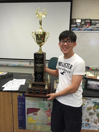 Piano junior Stefan Wan stands with the trophy he received from the Florida State Science Fair after placing first in the Environmental category.  Wan was able to advance onto the International Science and Engineering Fair held in Phoenix, Arizona on May 8-13 where he placed second in in Environmental Engineering.