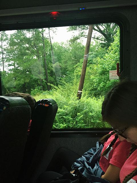 Outside the bus window, Georgetown, South Carolina is shown. Georgetown was a town that was significantly damaged by South Carolina's October floods, and Project Tikvah attendees went to people's homes to provide flood relief.