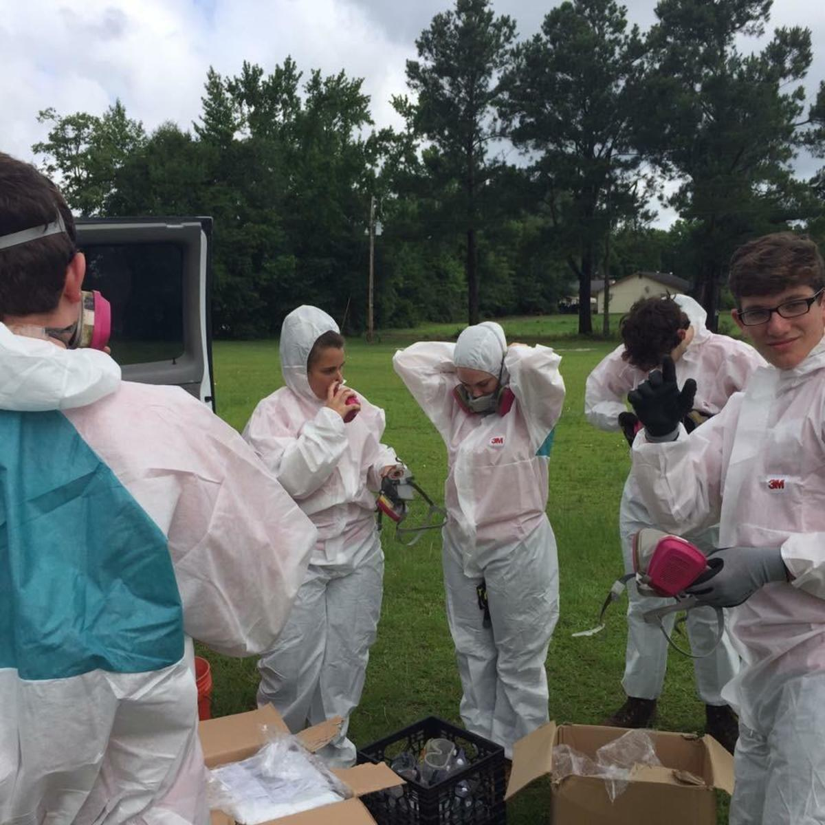 Clad in hazmat suits, goggles, and gas masks, Project Tikvah attendees went into a home in Georgetown, South Carolina to try and provide flood relief.