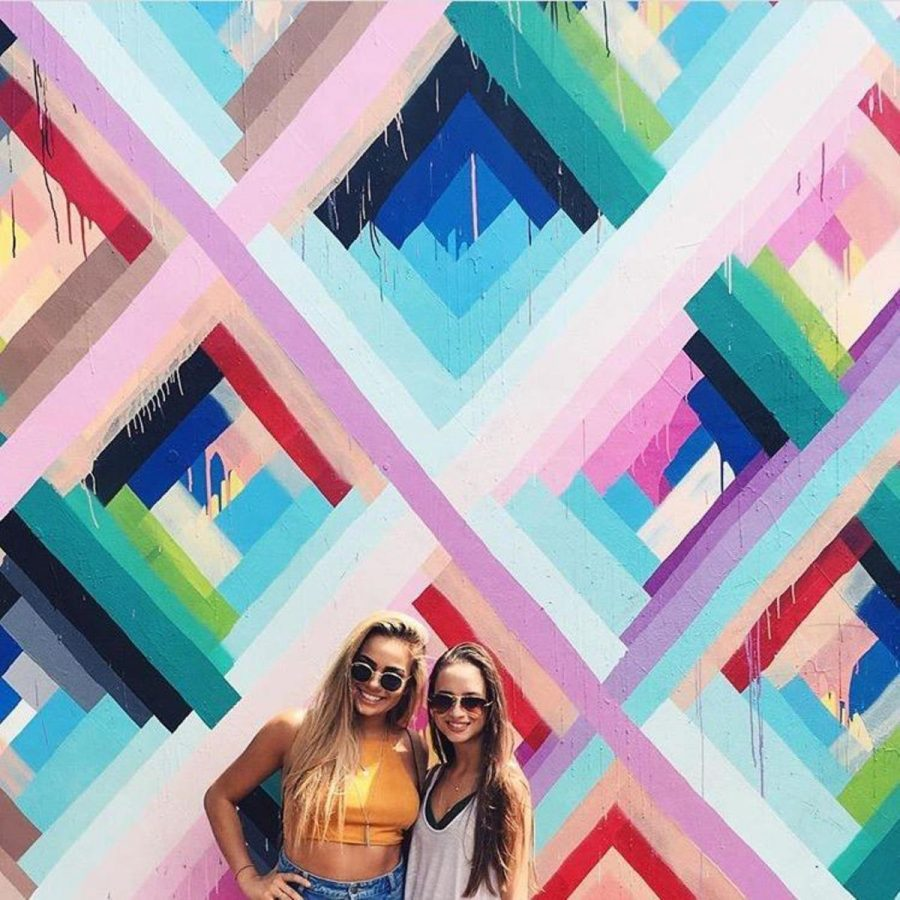 "Dance juniors Francesca Gabriel and Reagan Domino pose in front of a mural in Miami's Wynwood Art District. ""Now that it's summer, I feel like I have full freedom to explore new places and acquire new experiences,"" Domino said. ""Being in a pair of awesome sunglasses with your best friends by your side definitely doesn't hurt."""