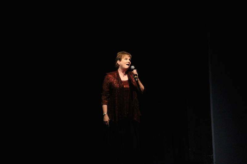 """Vocal director Arlene Sparks sings a rendition of """"Over the Rainbow,"""" for Mr. Sims at the Tribute Show on Friday, May 27. It is the final time that Sparks will perform on a Dreyfoos stage."""