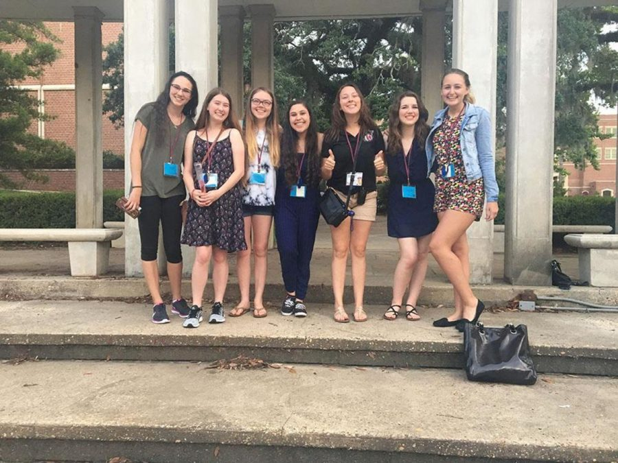 """Vocal juniors Sarah Haughn (second from left) and Alexa Burnston (middle) pose with their newfound friends at FSU Choral Ensemble Camp in Tallahassee, Florida. """"It was an amazing experience,"""" said Burnston. """"For a week, I feel like I truly got to live the life of a college student, minus the academic pressure and lack of money."""""""