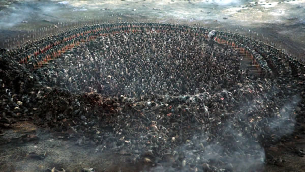 The Bolton Army forms a phalanx around the remaining Wildlings in Jon Snow's army.