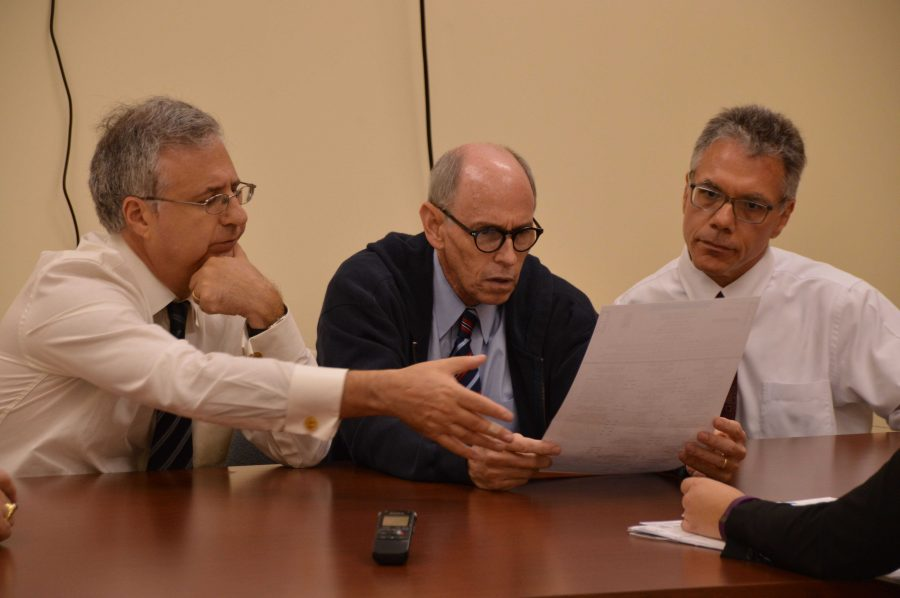 (L-R) County Commissioner Steven Abrams, Judge Leonard Hanser and Judge August Bonavita, members of the Supervisor of Elections' Canvasing Board, review a rejected absentee ballot. The Canvasing Board studies each ballot and attempt to determine the intent of the voter.